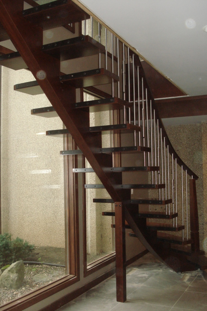 28 - Modern stair with single stringer with custom tapered newel and